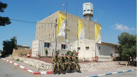 IDF (Israeli Defence Forces) soldiers sitting in front of Matat fort
