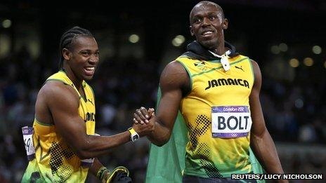 """Jamaica""""s Usain Bolt (R) shakes hands with team mate and second-placed Yohan Blake after winning the men's 100m final during the London 2012 Olympic Games"""