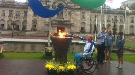 Paralympian Simon Richardson lights the flame outside Cardiff City Hall