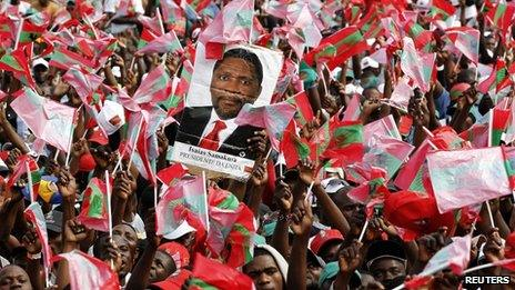 Supporters of Angola's opposition UNITA party with a poster showing their leader Isaias Samakuva during an election rally in Luanda