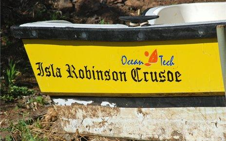 Boat with Robinson Crusoe sign at back
