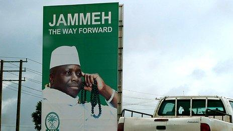 Roadside billboard with image of the president