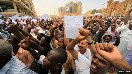 Sudanese demonstrators walk out after Friday prayers to protest in front of the the German and US embassies in Khartoum on Friday