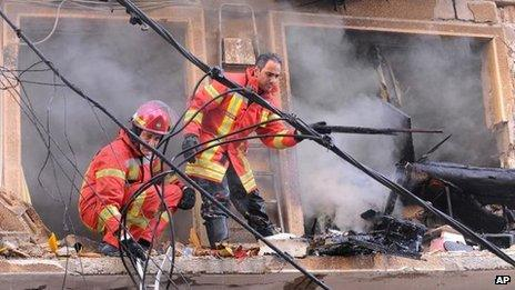 Rescue workers remove rubble from building damaged in Beirut blast (19 October)
