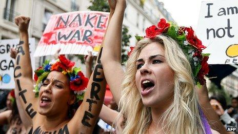 Topless activists from Ukraine's Femen group protest in Paris