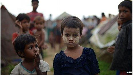 Two Rohingya children in a displaced camp