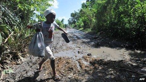 Child walks through damaged fields in Leogane - 27 October