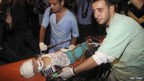 Child injured in air strike, Gaza City, 14 Nov 12