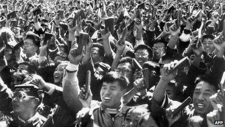 """Chinese youths waving copies of Chairman Mao Zedong's """"Little Red Book"""" as the celebrates China's National Day in Beijing, October 1967"""