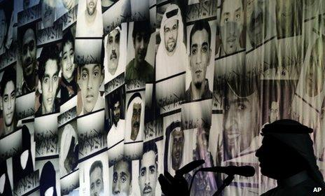 Hussein Niema addresses a pro-democracy rally in Muqsha, in front of pictures of those killed in Bahrain since February 2011