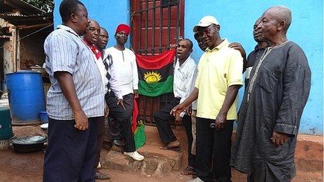 Men sing anthem alongside Biafran flag