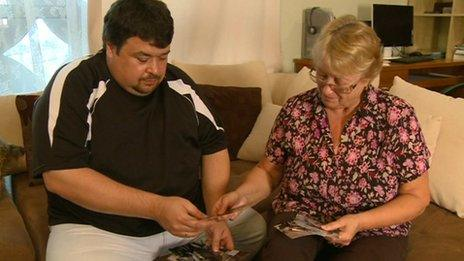 Tatyana Shikhmuradova and her son Bayram look at photos of Boris Shikhmuradov
