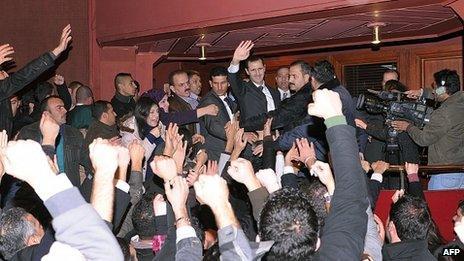 Bashar al-Assad is mobbed at the end of his address