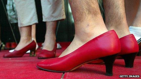 Two men wearing modern high heels