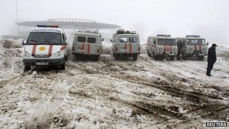 Emergencies Ministry vehicles and ambulances are parked near the site of the plane crash outside Almaty January 29, 2013.