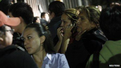 Relatives of Pemex employees wait for information of their family members outside Pemex hospital in Mexico City, 31 January 2013