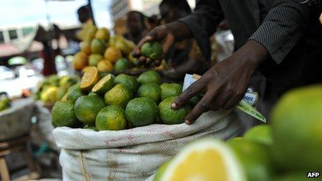 (File photo 2011) A stall holder sells fruit in Nakasero Market, Kampala