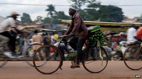 (File photo 2008) a man rides a bicycle in Kampala