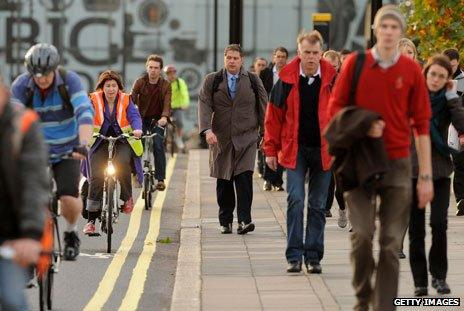 Commuters head to work on bikes and on foot