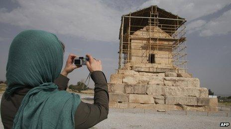 A visitor takes a picture of the limestone tomb of ancient Persia's King Cyrus the Great, in Pasargadae, 950km south of Tehran, Iran