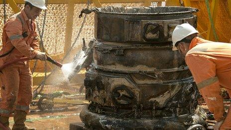 Workers clean F-1 engine aboard Seabed Worker