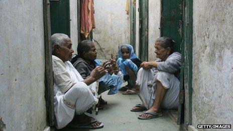 Indian widows chat outside their quarters at an ashram (spiritual commune)