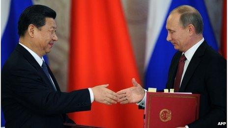 """Vladimir Putin (R) and Xi Jinping (L) attend the opening ceremony of """"The Year of Chinese Tourism in Russia"""" in Moscow, on March 22"""