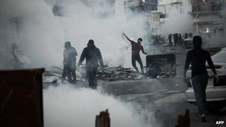 Bahraini protestors confront and riot police in the village of Daih, west of Manama, on March 8, 2013.