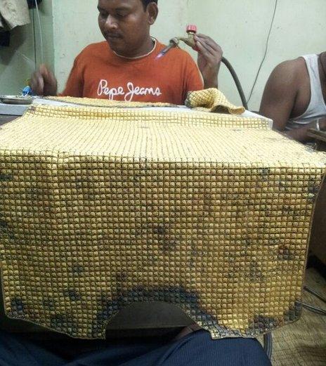 Man making shirt