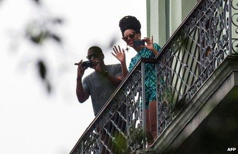 US singer Beyonce is seen on a balcony of the Saratoga Hotel in Havana next to her husband Jay Z, 5 April