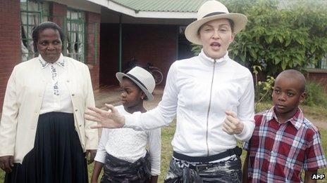 Madonna with her children and Yasinta Chapomba, Executive Director of Mphandula Childcare Centre, in Namitete, Malawi, on 5 April 2013