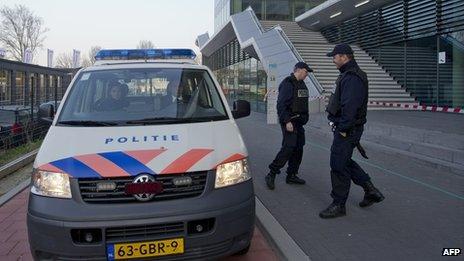 Dutch police stand outside the Da Vinci College in Leiden on 22 April 2013