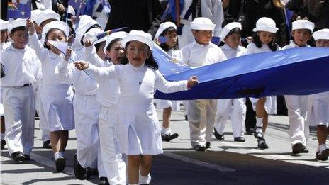 Children march during an event honouring national hero Eduardo Avaroa, who died in the 1879-1884 War of the Pacific, as part of Sea Day celebrations in La Paz, Bolivia, Saturday, 23 March 2013
