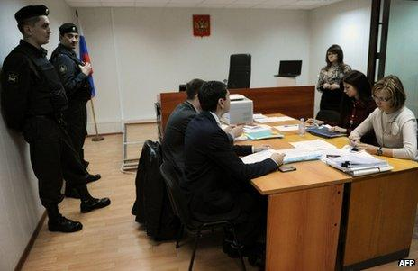 Court officials and lawyers attend the NGO hearing in Moscow, 25 April