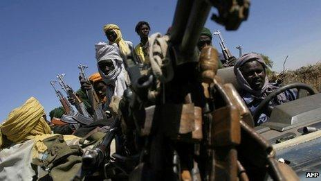 Members of Sudan Liberation Army (SLA), one of the groups in the local rebellion, arrive for a meeting with the African Union ceasefire commission in Tabit town, south of the city of al-Fasher, to hand over a thief arrested by the SLA, 01 December 2004