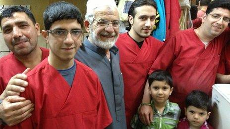 Haj Abed (grey shirt) with his staff