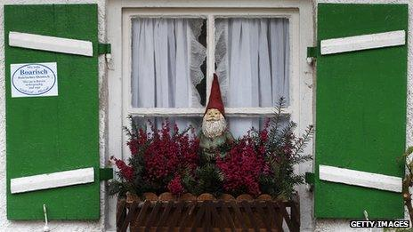 A typical German garden gnome in a window box
