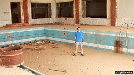 Joe Twyman in the ruins of a swimming pool which belonged to Saddam Hussein
