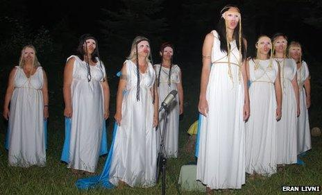 Worshippers take part in a play on Mount Olympus