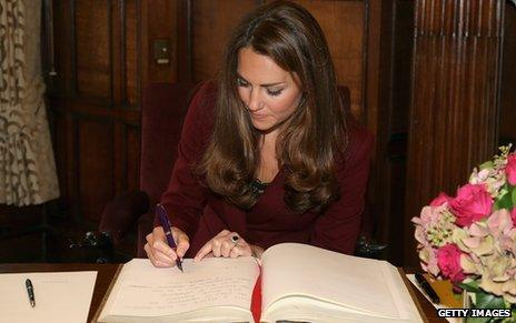 Duchess of Cambridge signing book