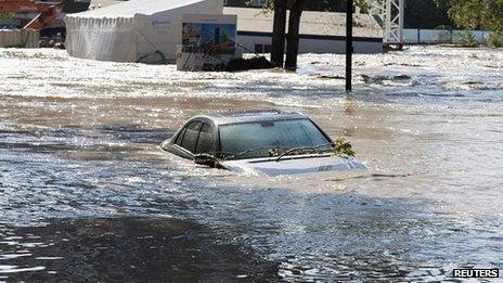 Abandoned car submerged in the Mission area of Calgary, Alberta. 22 June 2013