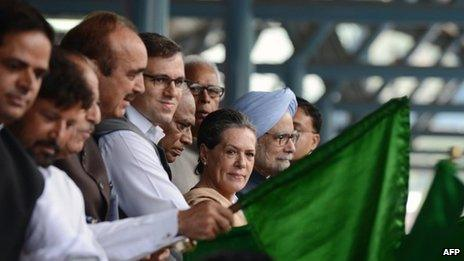 Indian Prime minister Manmohan Singh (R) and Congress party President Sonia Gandhi (2nd R) flag off a train service running between Banihal and Qazigund at a station in Banihal, some 110 kms south of srinagar, on June 26, 2013.