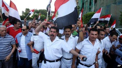 Police officers march in Cairo, 30 June