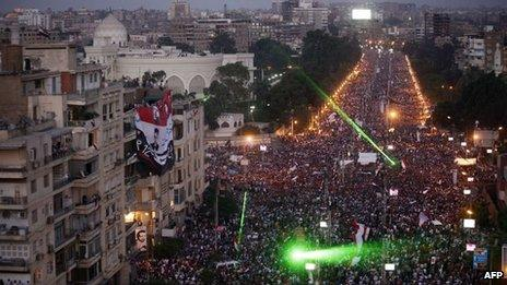 Protesters fill an avenue near the presidential palace in Cairo, 30 June
