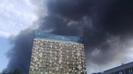 Smoke is seen drifting over Birmingham city centre