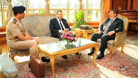 Gen Abdel Fattah al-Sisi, the head of Egypt's armed forces, left, Prime Minister Hisham Qandil and President Mohammed Morsi