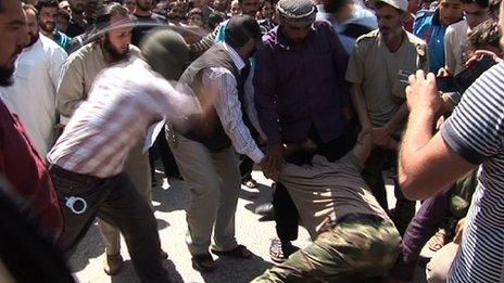 A prisoner is whipped in the street as punishment for highway robbery under Saraqeb's Sharia law system