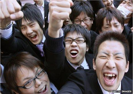 Japanese men celebrating with fists in the air