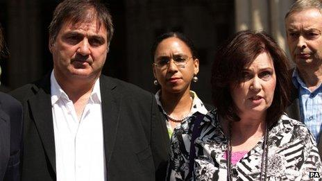"""Michelle Diskin (second right) reads a statement on behalf of her brother Barry George (left), who spent eight years in prison after being wrongly convicted of the murder of TV presenter Jill Dando, outside the Royal Courts of Justice, London, where he lost his legal battle for compensation as a victim of a """"miscarriage of justice"""" in the Court of Appeal"""