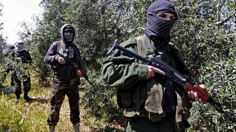 Members of the Hezbollah-backed Lebanese pro-Syrian Popular Committees stand guard at the Syrian border - April 2013
